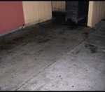 Greasy floor before pressure washing