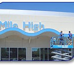 Exterior building pressure washing for Mile High Auto