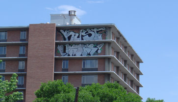 Graffiti on high rise building removed by Wash On Wheels