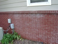 Pressure Washing The White Stains On A Brick House